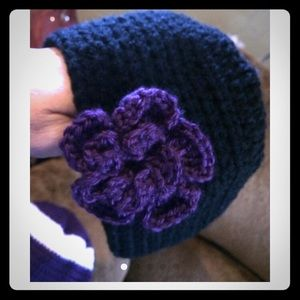 Beanie hat with flower.